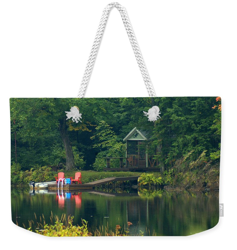 Landscape Weekender Tote Bag featuring the photograph Dockside Awaits by Jerry Deroo