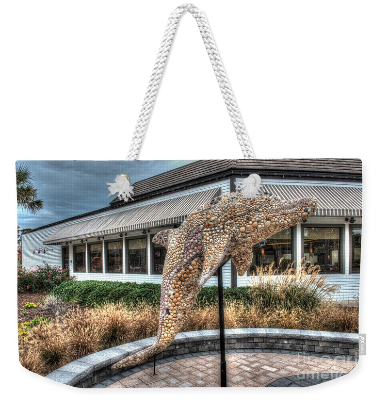 Captain Georges Weekender Tote Bag featuring the photograph Dolphin Shell Art Sculpture by Greg Hager