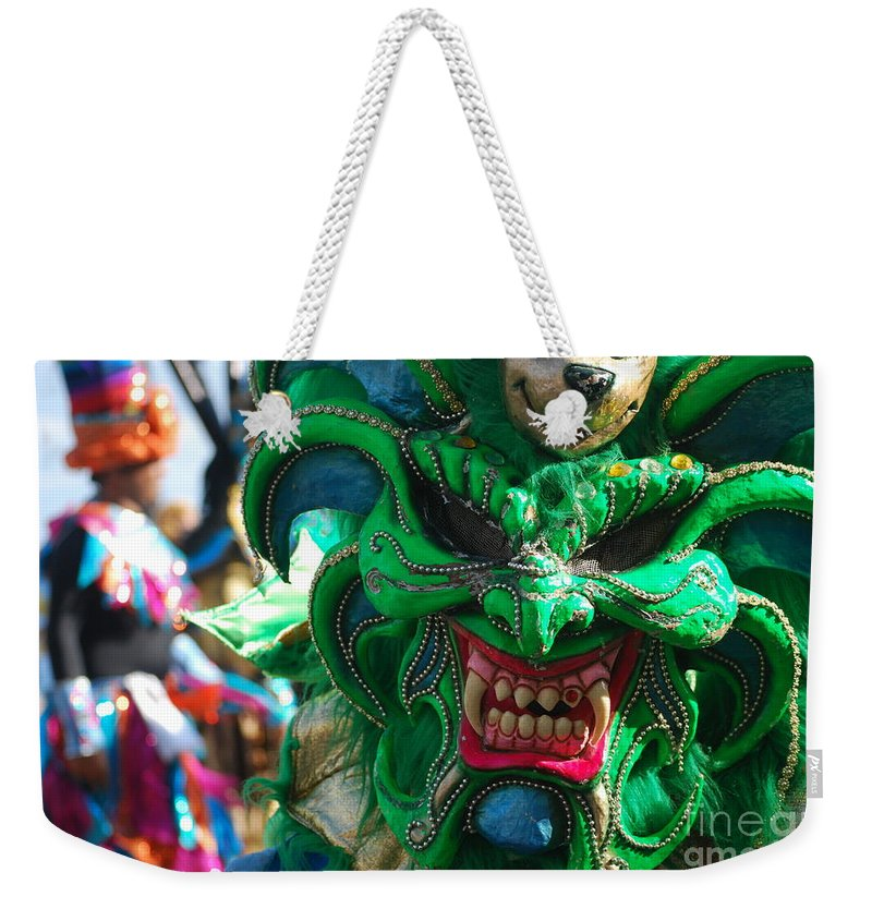 Carnival Weekender Tote Bag featuring the photograph Dominican Republic Carnival Parade Green Devil Mask by Heather Kirk