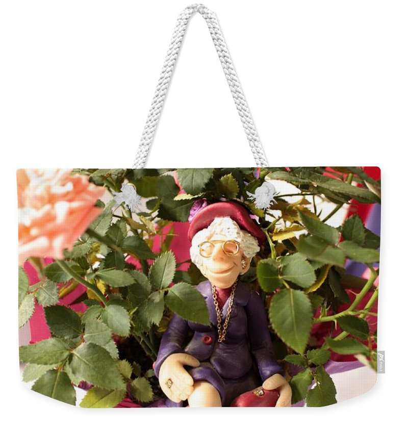 Red Hats Weekender Tote Bag featuring the photograph Don't Forget To Stop And Smell The Roses by Carol Groenen