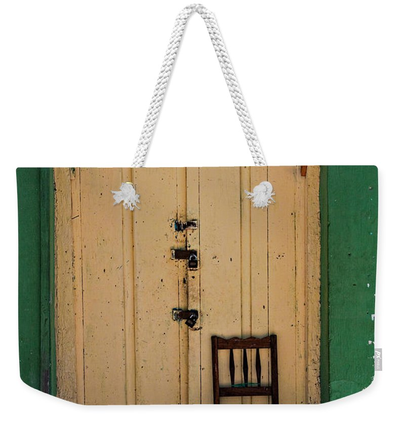 Door Weekender Tote Bag featuring the photograph Door And Chair by Tatiana Travelways