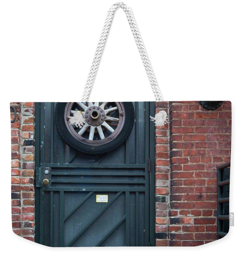 Door Weekender Tote Bag featuring the photograph Door And Wheel by Douglas Barnett