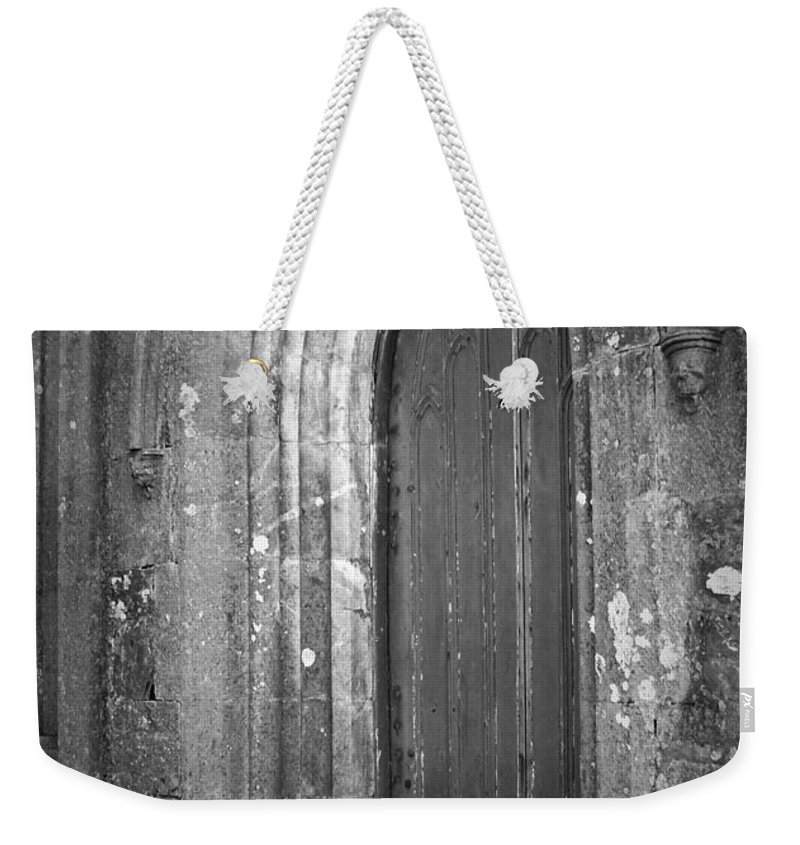 Irish Weekender Tote Bag featuring the photograph Door At Protestant Church Macroom Ireland by Teresa Mucha