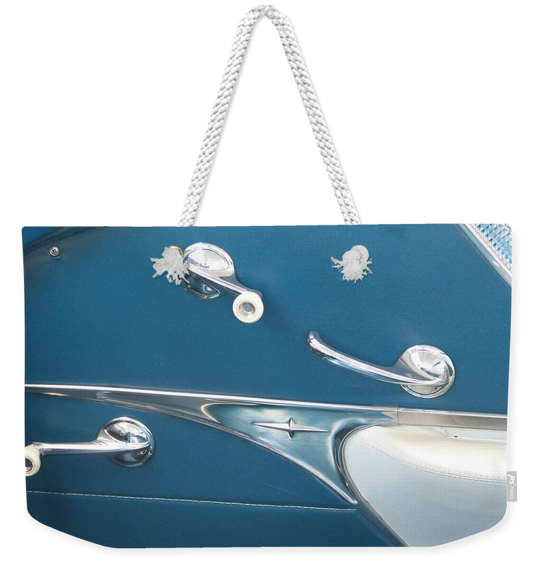 Pontiac Weekender Tote Bag featuring the photograph Door Parts by Kelly Mezzapelle