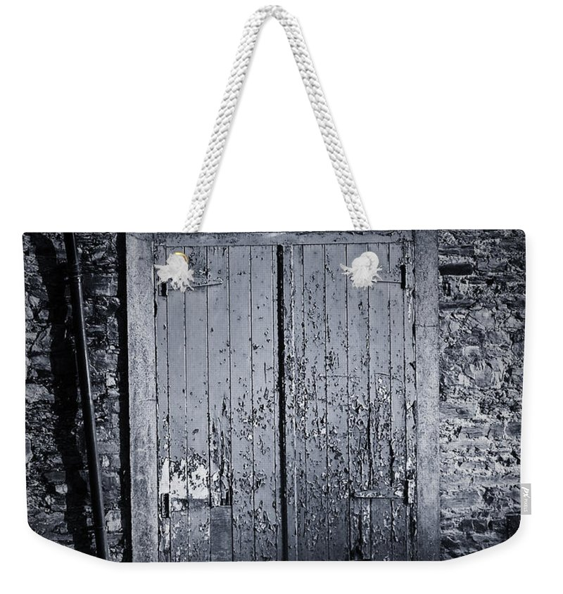 Irish Weekender Tote Bag featuring the photograph Door To Nowhere Blarney Ireland by Teresa Mucha