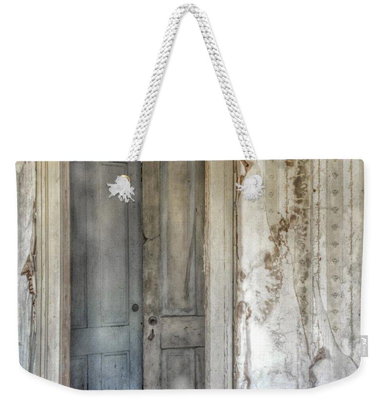 Foyer Weekender Tote Bag featuring the photograph Doorway To Doors by Margie Hurwich
