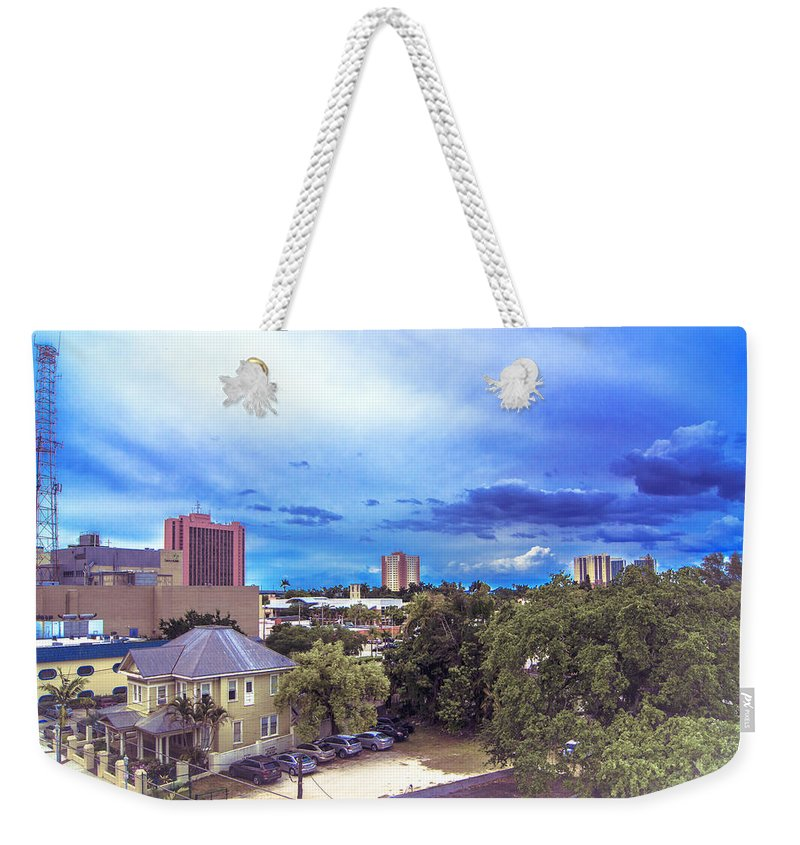 Downtown Skies Weekender Tote Bag featuring the photograph Downtown Skies by Michael Frizzell