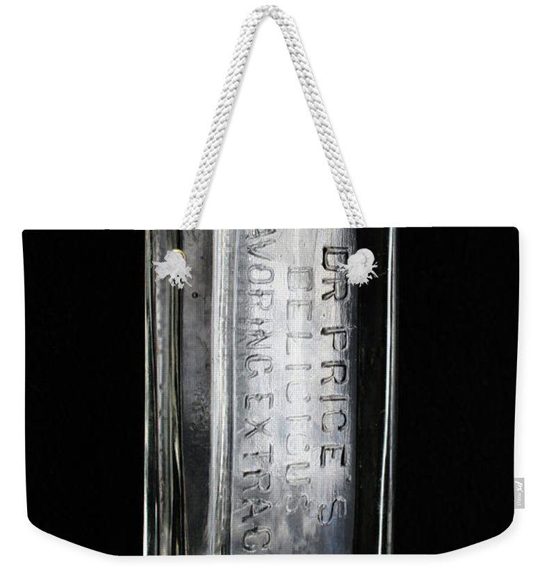Glass Bottle Weekender Tote Bag featuring the photograph Dr Price's Delicious Flavoring Extracts by Ric Bascobert