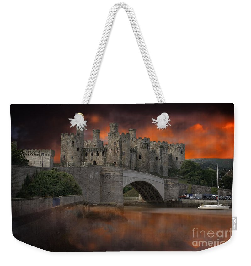 Architecture Weekender Tote Bag featuring the photograph Dramatic Sky Over Castell Conwy by MSVRVisual Rawshutterbug