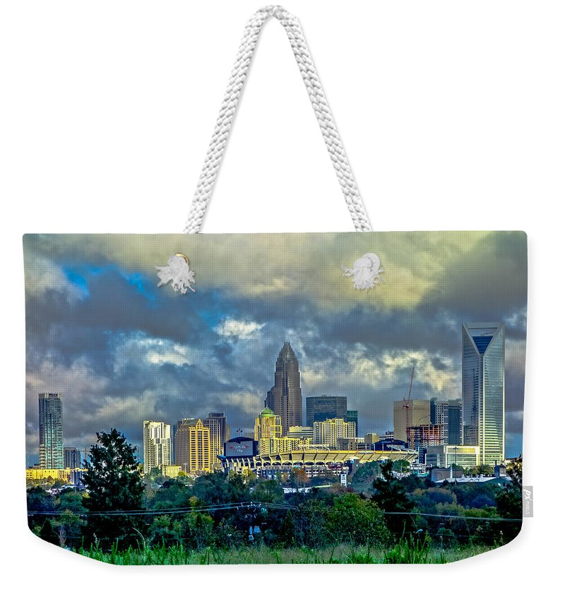 Dramatic Weekender Tote Bag featuring the photograph Dramatic Sky With Clouds Over Charlotte Skyline by Alex Grichenko