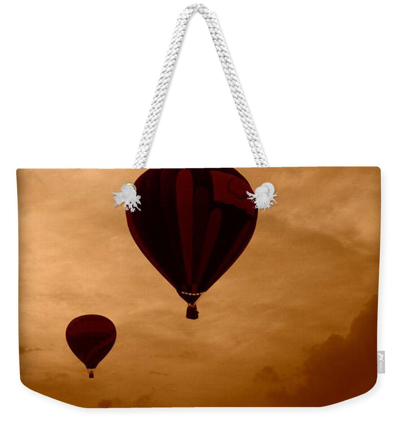 Dreaming Weekender Tote Bag featuring the photograph Dreaming by Linda Sannuti