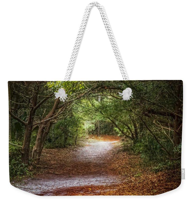 Clouds Weekender Tote Bag featuring the photograph Dreamy Walk by Debra and Dave Vanderlaan