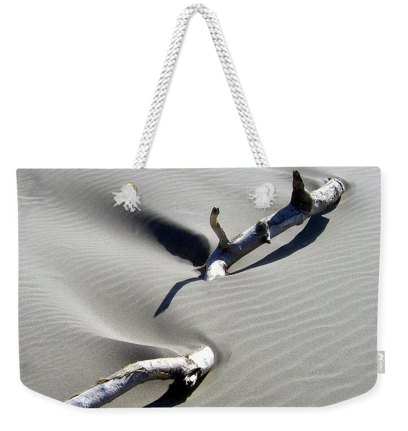 Driftwood Weekender Tote Bag featuring the photograph Drifting Sand by Will Borden