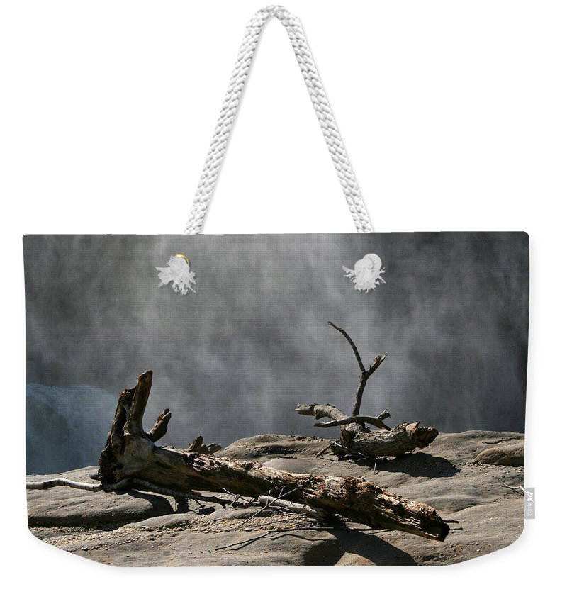 Wood Drift Driftwood Rock Mist Waterfall Nature Sun Sunny Waterful Glow Rock Old Aged Weekender Tote Bag featuring the photograph Driftwood by Andrei Shliakhau