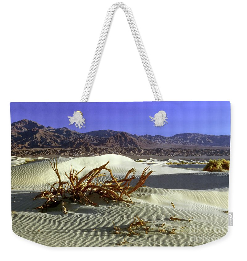 Sand Weekender Tote Bag featuring the photograph Driftwood Dune by Jim And Emily Bush