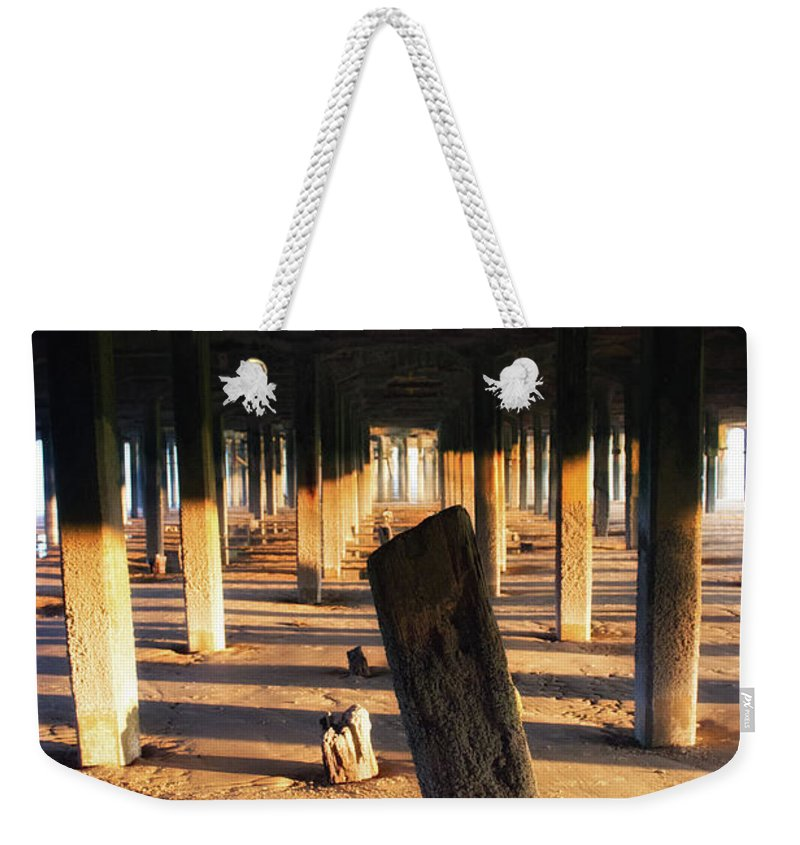 Pier Weekender Tote Bag featuring the photograph Driftwood by Martin Newman