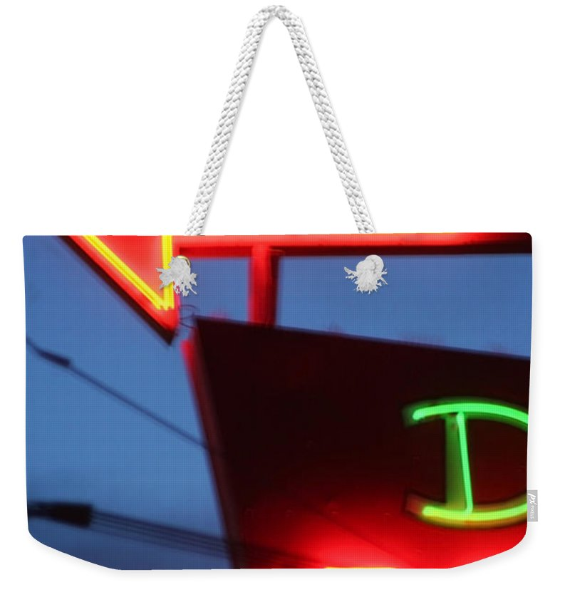 Neon Weekender Tote Bag featuring the photograph Driftwood Motel by Jeffery Ball