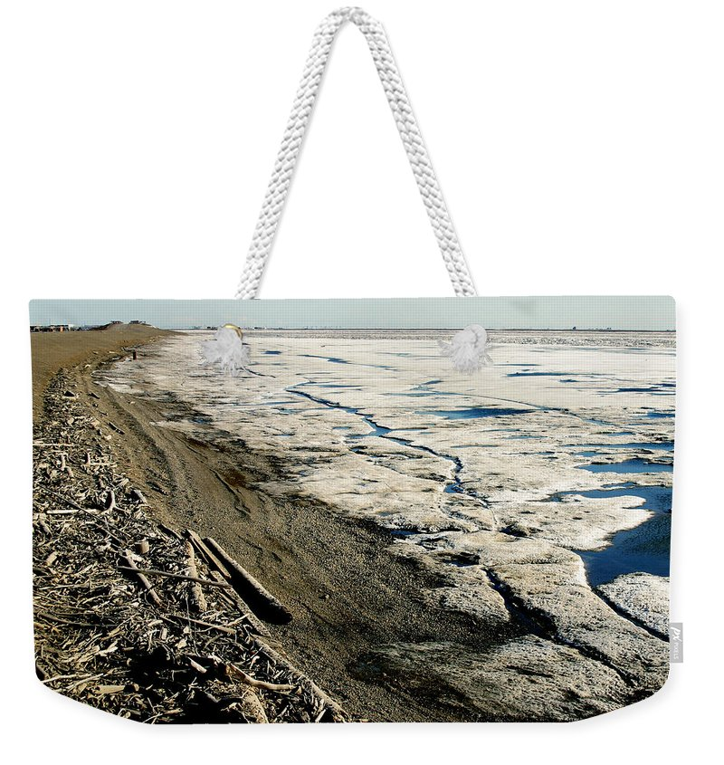 Drift Wood Weekender Tote Bag featuring the photograph Driftwood On The Frozen Arctic Coast by Anthony Jones