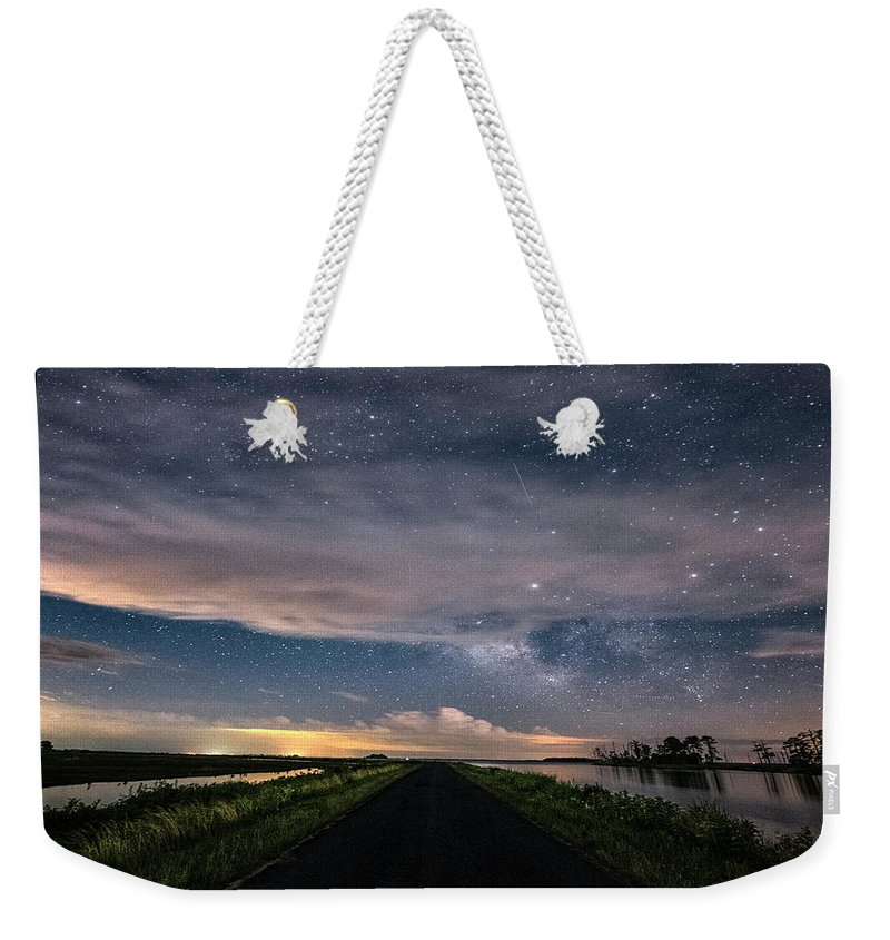 Maryland Weekender Tote Bag featuring the photograph Drive Into The Wild by Robert Fawcett