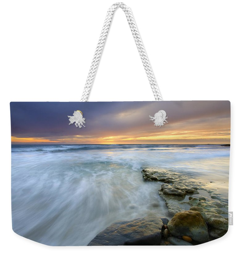 Rocks Weekender Tote Bag featuring the photograph Driven Before The Storm by Mike Dawson