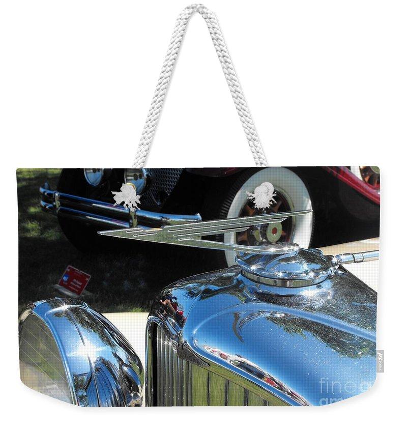 Duesenberg Weekender Tote Bag featuring the photograph Duesenberg Hood Ornament by Neil Zimmerman