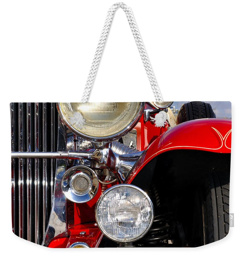 Car Weekender Tote Bag featuring the photograph Duesenberg by Tim Nyberg