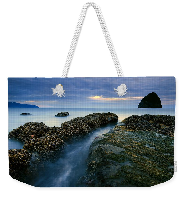 Haystack Rock Weekender Tote Bag featuring the photograph Dusk At Kiwanda by Mike Dawson