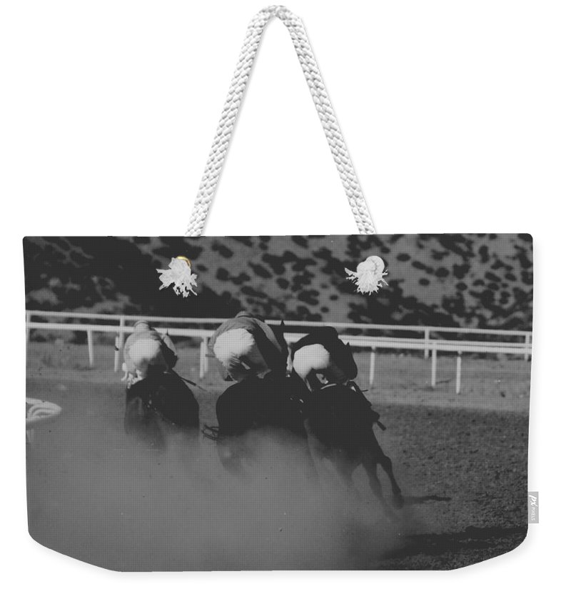 Horse Weekender Tote Bag featuring the photograph Dust and Butts by Kathy McClure