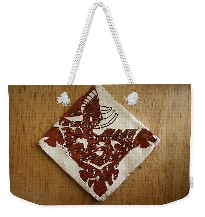 Jesus Weekender Tote Bag featuring the ceramic art Eagle Eye - Tile by Gloria Ssali