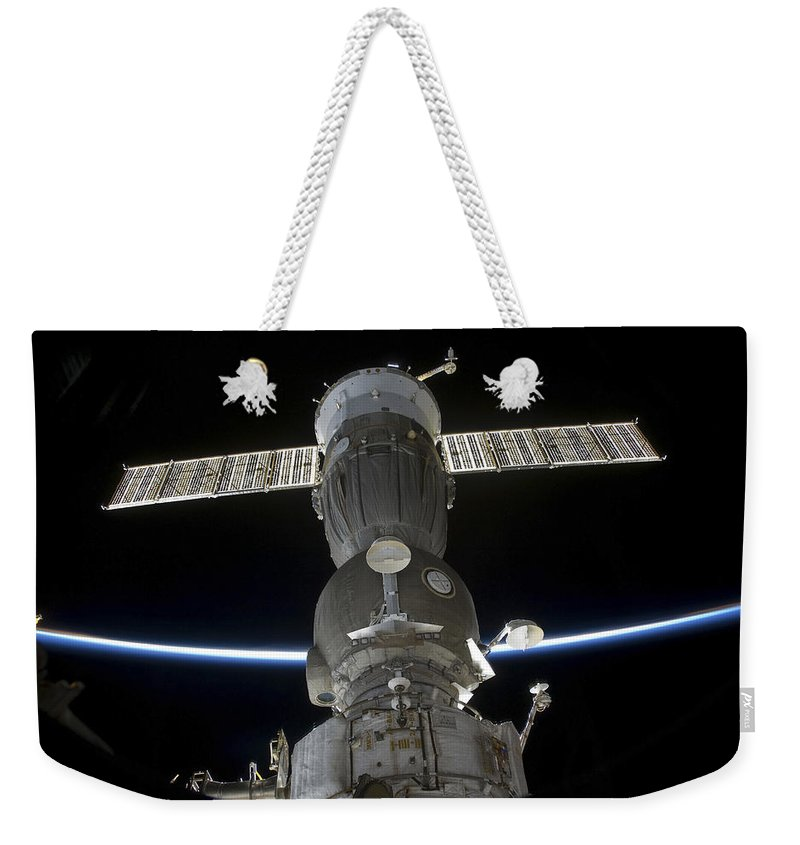 Sts-127 Weekender Tote Bag featuring the photograph Earths Limb Intersects A Soyuz by Stocktrek Images