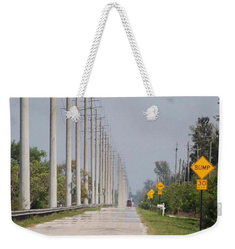 Trees Weekender Tote Bag featuring the photograph East Bound And Down by Rob Hans