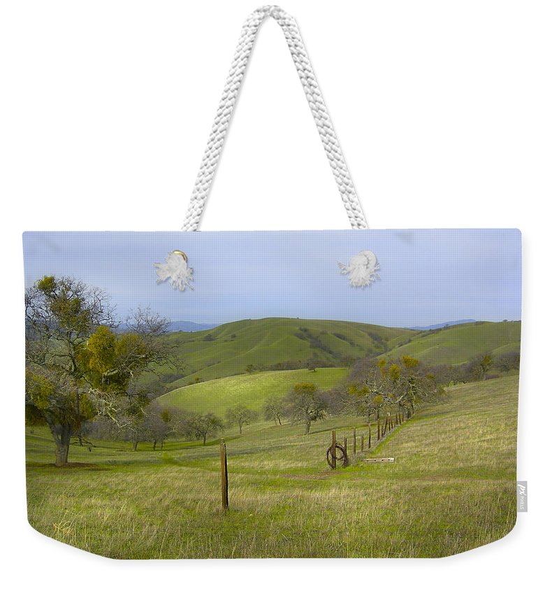 Landscape Weekender Tote Bag featuring the photograph East Ridge Trail Barbed Wire by Karen W Meyer