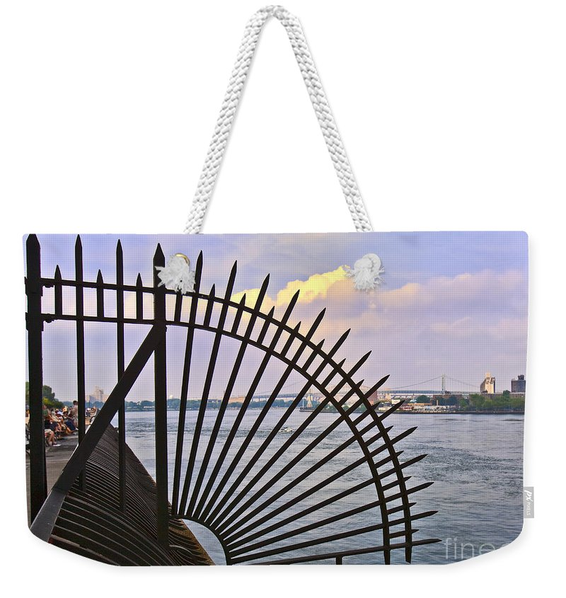 East River Weekender Tote Bag featuring the photograph East River View Through The Spokes by Madeline Ellis