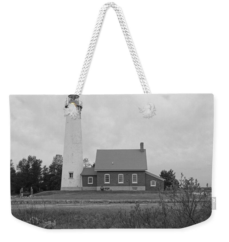 East Tawas Lighthouse Weekender Tote Bag featuring the photograph East Tawas Lighthouse by Michiale Schneider