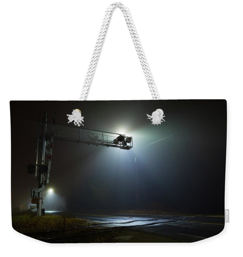 Eerie Intersection Railroad Rail Road Tracks Trax Light Night Outside Outdoors West W Boylston Ma Mass Massachusetts Fog Foggy Misty Mist Brian Hale Brianhalephoto Traintrack Train Moody Crossing Weekender Tote Bag featuring the photograph Eerie Intersection by Brian Hale