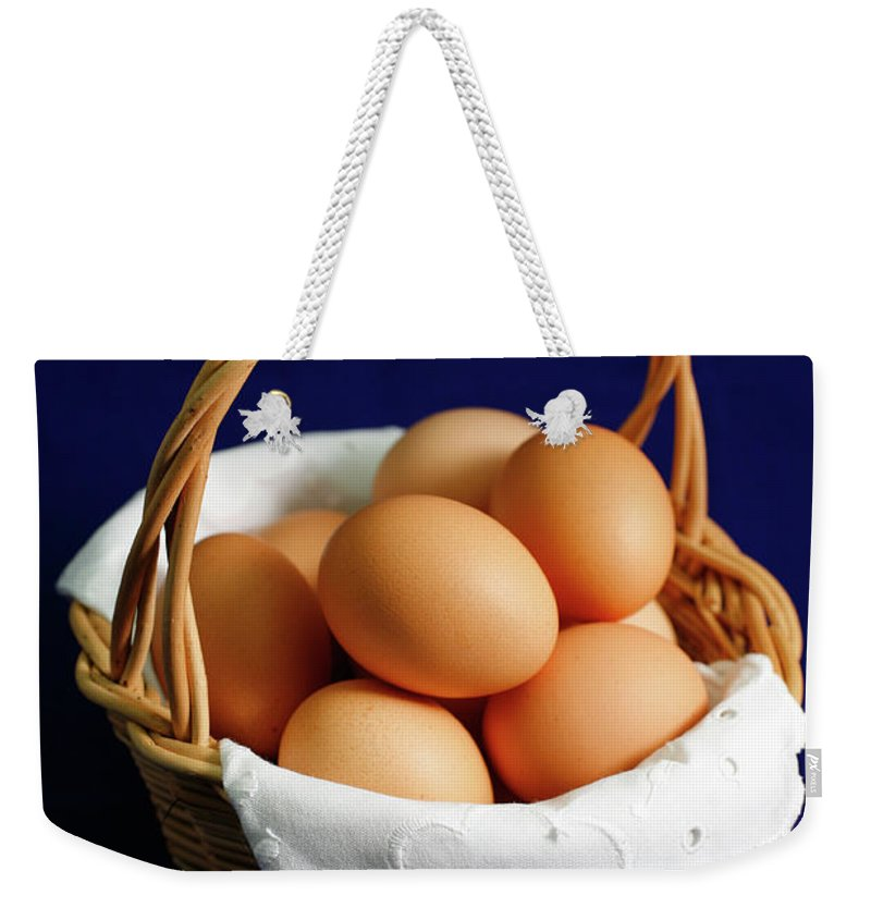 Eggs Weekender Tote Bag featuring the photograph Eggs In A Wicker Basket. by Gaspar Avila