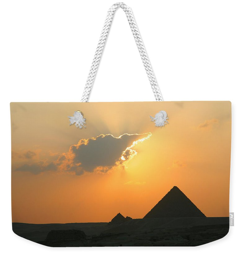 Pyramid Weekender Tote Bag featuring the photograph Egpytian Sunset Behind Cloud by Donna Corless