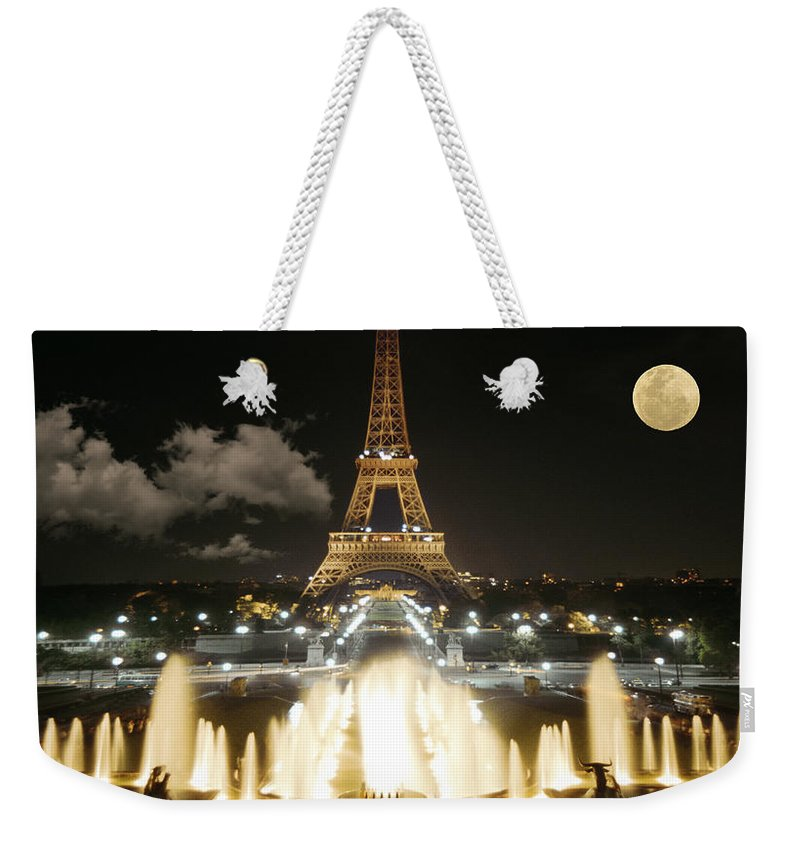 Paris Weekender Tote Bag featuring the photograph Eiffel Tower At Night by Jon Delorme