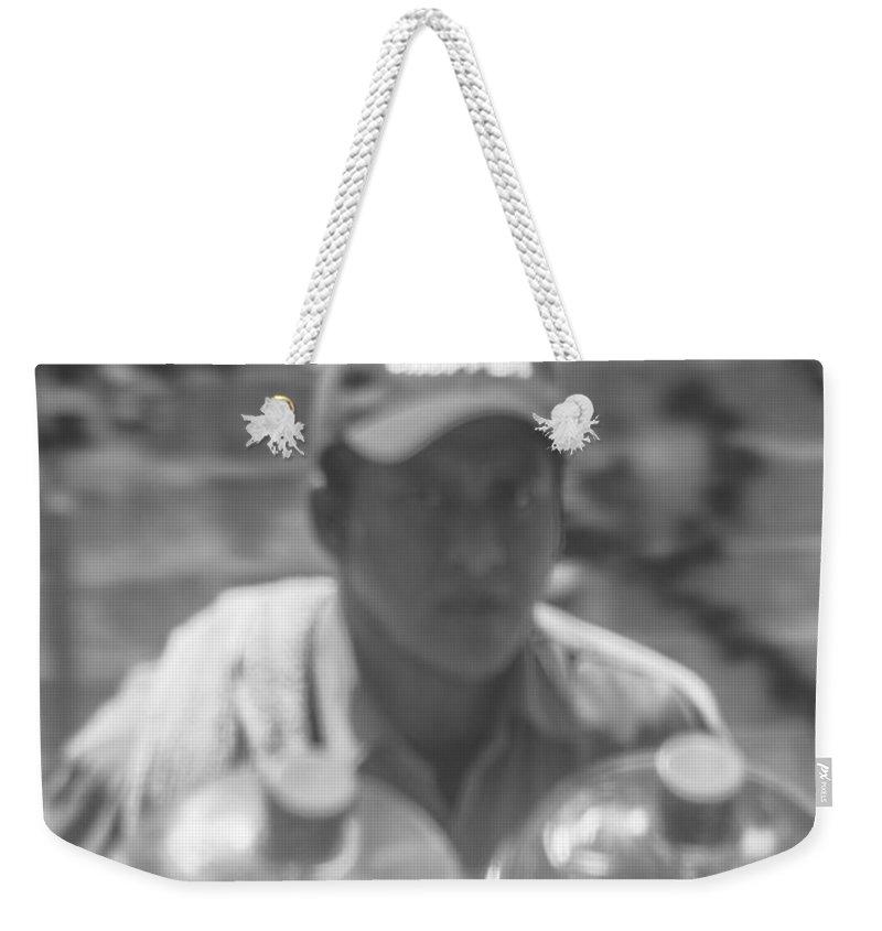 Despachador De Agua Weekender Tote Bag featuring the photograph El Agua by Totto Ponce