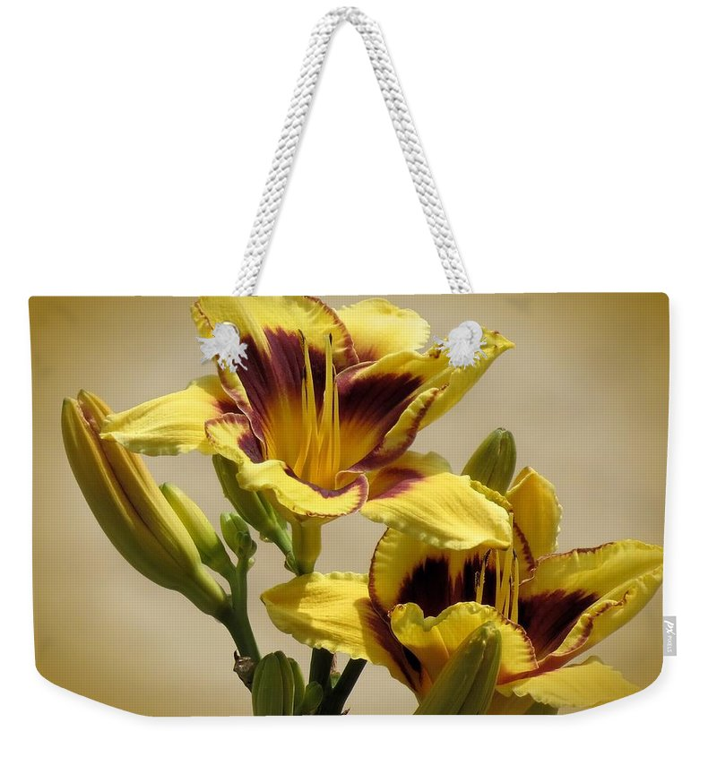 El Bandito Daylilies Weekender Tote Bag featuring the photograph El Bandito Daylilies - Yellow by MTBobbins Photography