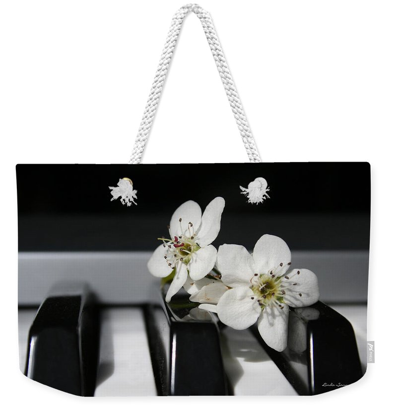 Still Life Photography Weekender Tote Bag featuring the photograph Elegant by Linda Sannuti