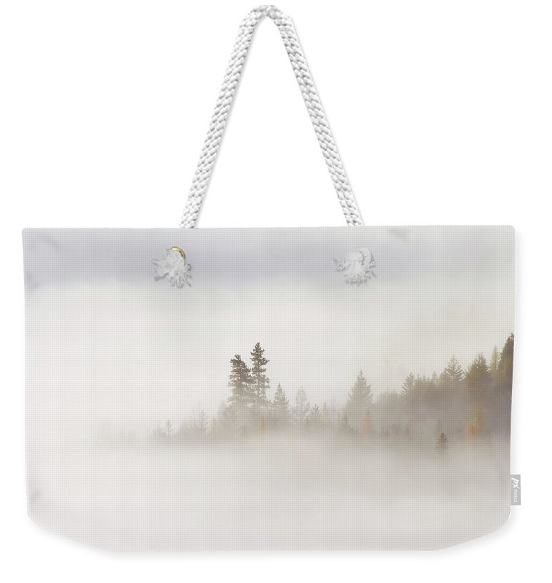 Fog Weekender Tote Bag featuring the photograph Emergence by Mike Dawson
