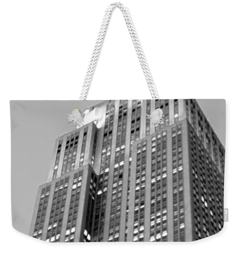 Architecture Weekender Tote Bag featuring the photograph Empire State Building B W by Rob Hans