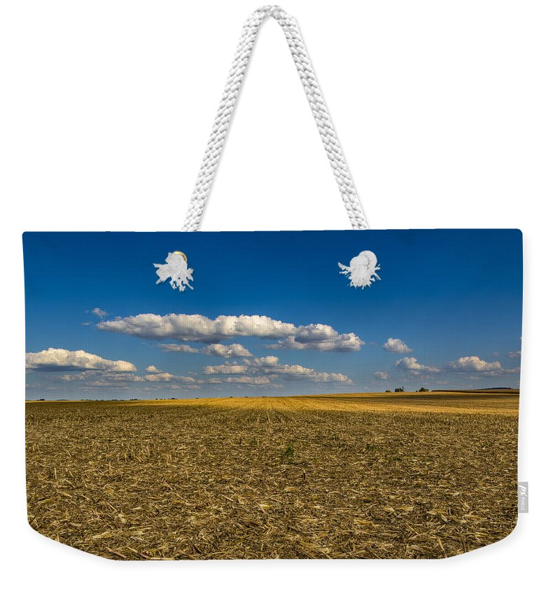 Farmland Weekender Tote Bag featuring the photograph End Of A Season by Jeff Sebaugh
