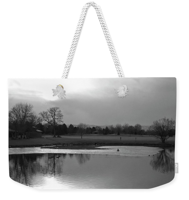 Reflections Weekender Tote Bag featuring the photograph End Of Day Reflections by Angus Hooper Iii