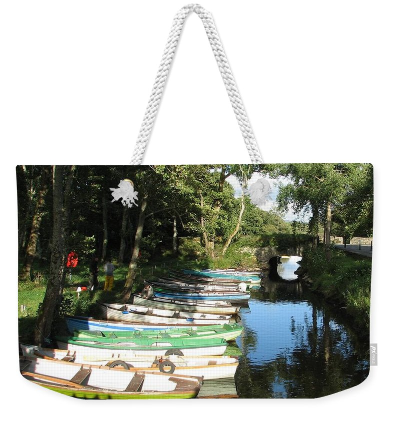 Boat Weekender Tote Bag featuring the photograph End Of The Day by Kelly Mezzapelle