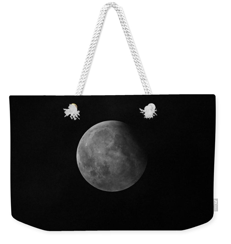Super Moon Weekender Tote Bag featuring the photograph End Of The Eclipse by Paul Wilford