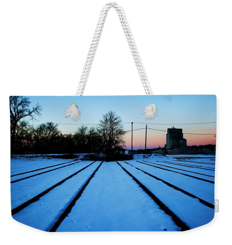 Sunset Weekender Tote Bag featuring the photograph End Of The Tracks by Angus Hooper Iii