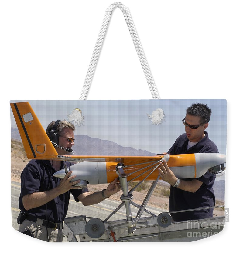 Boeing Weekender Tote Bag featuring the photograph Engineers Mount A Scaneagle Unmanned by Stocktrek Images
