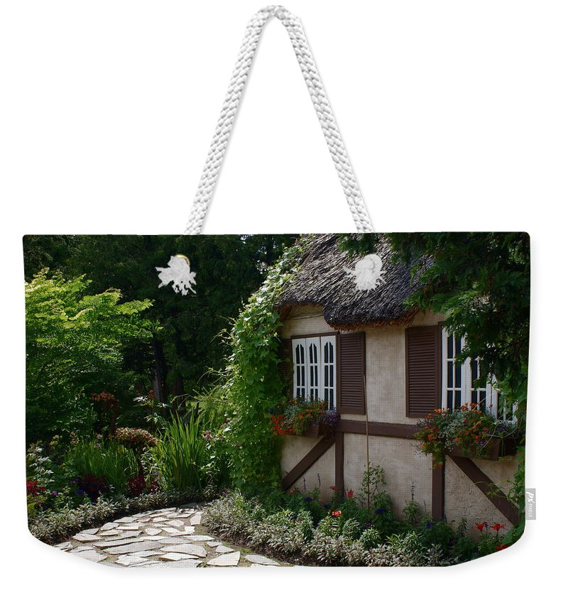 English Cottage At Leo Mol Gardens Assiniboine Park Winnipeg Weekender Tote Bag featuring the photograph English Cottage by Joanne Smoley